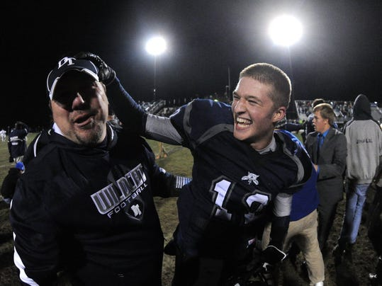 Dallastown QB Andrew Henry, right, celebrates the Wildcats' 21-20 victory against CD East during the District 3 quarterfinals in Dallastown on Nov. 15, 2013. (Jason Plotkin - Daily Record/Sunday News)