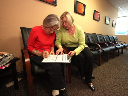 Diana Meinhold, a licensed professional fiduciary in California, helps her client Esther Danielson prepare for an appointment.