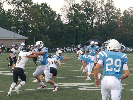 Collins senior quarterback J.R. Lucas is trying to