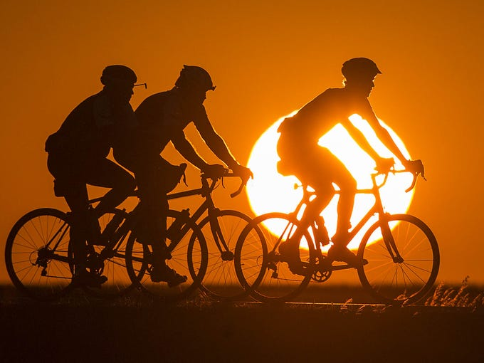 Riders start the day early outside Fort Dodge on the