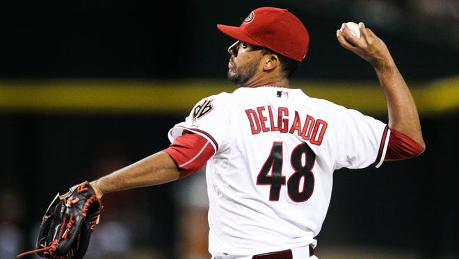 Arizona Diamondback's pitcher Randall Delgado throws in the seventh inning at Chase Field in Phoenix on Tuesday, June 30, 2015.