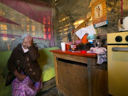 Selerina Guadalupe Villa, 85, sits in her home in Ecatepec,