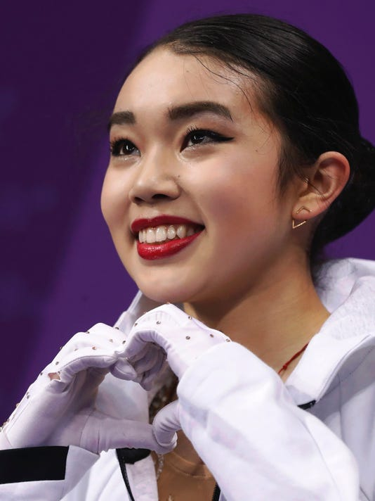 Karen Chen of the United States reacts as her scores are posted following her performance in the women's short program figure skating in the Gangneung Ice Arena at the 2018 Winter Olympics in Gangneung, South Korea, Wednesday, Feb. 21, 2018. (AP Photo/Bernat Armangue)