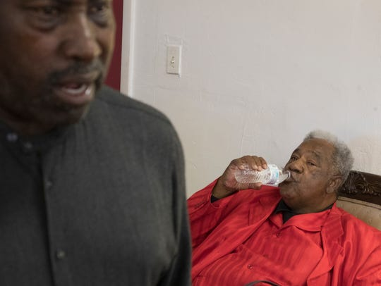 James Ford takes a swig of water during a church service