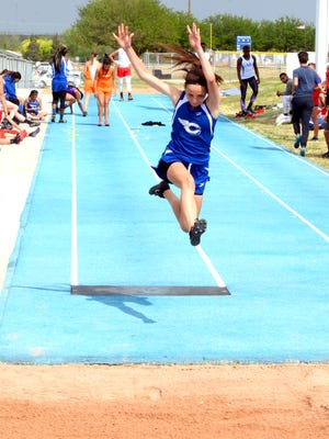 Carlsbad sophomore Kendal Parham catapults into the dirt during the girls long jump Friday at the Ron Singleton Invite.