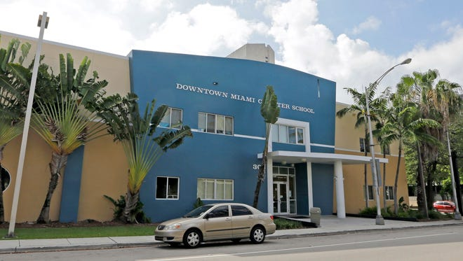 This Wednesday, May 17, 2017 photo shows the Downtown Miami Charter School in Miami. In 2012, the mother of a second-grade student at the school filed suit after she said she pleaded in vain for months for administrators to protect her son from sexual abuse by an older boy at the charter school. Eventually, the 7-year-old tried to kill himself by walking into traffic with his eyes closed, according to the family's lawsuit. Two years later, the boy testified, he still had nightmares his tormentor would crawl in through his bedroom window and kill his mother.