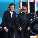 Paul McCartney, left, and Ringo Starr perform on stage at the 56th annual Grammy Awards at Staples Center on Sunday, Jan. 26, 2014, in Los Angeles.