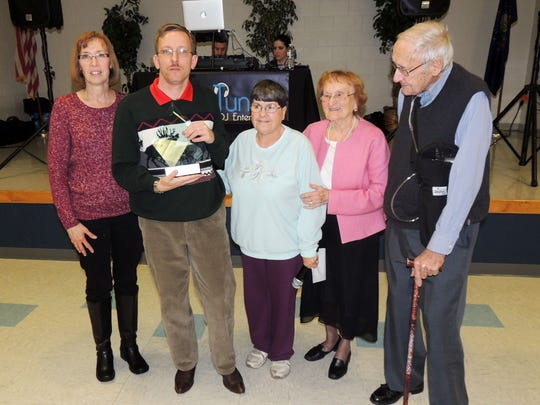 David Heflin, second from left, is the 2016 recipient of the Special Olympics Adams County John Steinour Athlete of the Year Award. Pictured from left are Wilma Noel of the Notre Dame Club; Heflin; Linda Masenheimer, president of the Notre Dame Club; and John Steinour's parents, Jean and Joe Steinour.