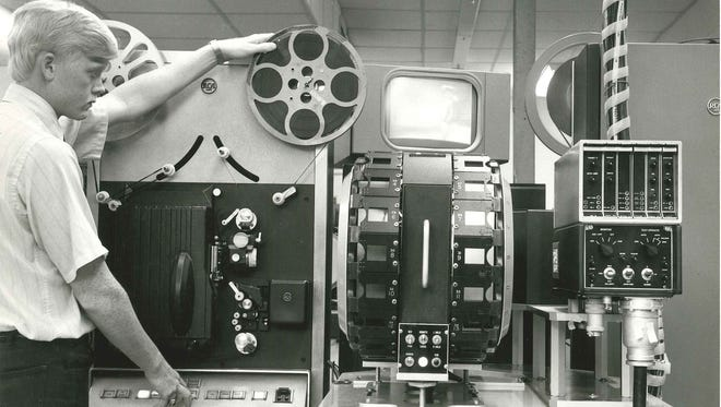 Jimmy Kuddes operates a film projector used to load movies for broadcast at KIII-TV's studios in the early 1970s.