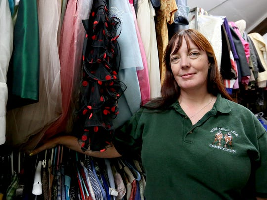 """Susan Schoaps has been volunteering at Pentacle Theatre since 1992 spending many hours in the theater's multi-roomed attic where costumes are stored. She said the tradition of telling stories about Pentacle's ghost """"Sheila,"""" who has been blamed for the sound of footsteps on the costume area's rickety floor, """"keeps the history of the theater alive."""""""