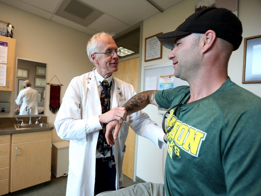 "Dr. William ""Bud"" Pierce performs a check-up on Scott Bloomfield, 36, of Stayton, a cancer remission patient, at Salem Health on Wednesday, May 18, 2016. Pierce won the May primary on Tuesday to run as the Republican gubernatorial candidate in the general election in November."