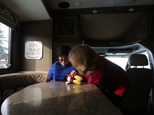 Khrizma Kuhn settles into her seat in her family's motor home with the help of her mom, Renee Kuhn, at their home in Woodburn, Ore., on Friday, Jan. 13, 2017. A federal judge recently ruled in favor of the family after their former Keizer homeowner's association prevented them from parking a motor home, used to transfer Khrizma to her medical appointmets, in their driveway.