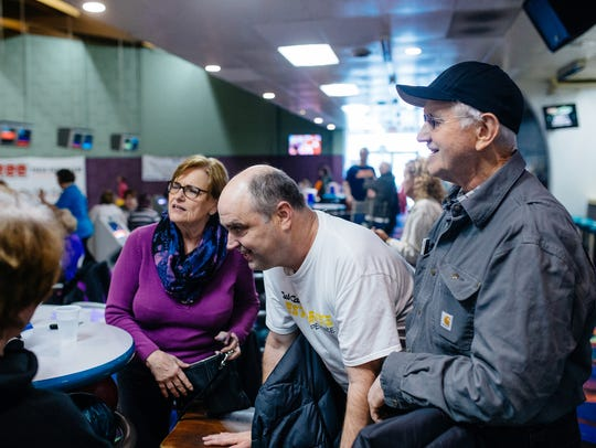 Ron Plewa (center), 46, of Shelby Township laughs with