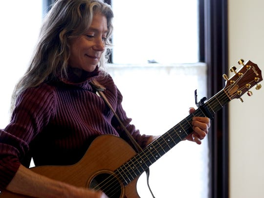 Maria Bulkow, a professional folk musician of Stayton, performs during a Folk Music Play-In at the Charles and Martha Brown House in Stayton on Sunday, March 5, 2017. Professional musicians and local amateurs performed together during the free event.