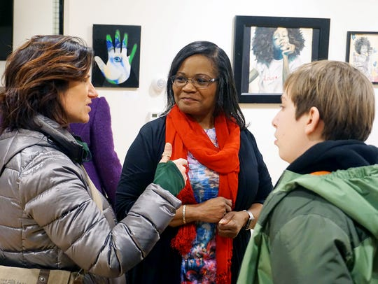 Ophelia M. Chambliss, center, speaks with Adrienne