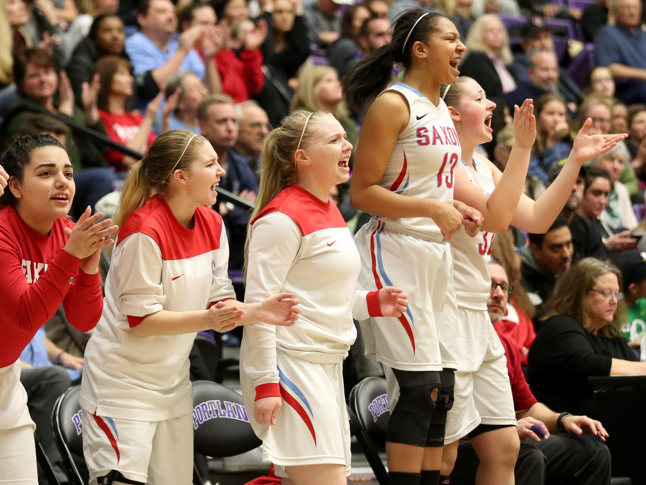 The South Salem bench celebrates a play during the second half of the Grant vs. South Salem girl's basketball game to determine third place in the OSAA Class 6A State Championships at the University of Portland on Saturday, March 11, 2017. South Salem won the game 58-53.