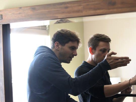 Joe Clarke, left, and Ben Handler shoot a scene in