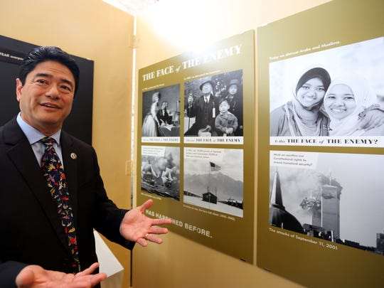 Dr. Mitchell Maki, looks through the Go For Broke National Education CenterÕs traveling exhibition debut of ÒCourage and Compassion: Our Shared Story of the Japanese American World War II Experience,Ó at the Willamette Heritage Center in Salem on Thursday, July 13, 2017. The Japanese-American history exhibit runs July 14 - Sept. 23.