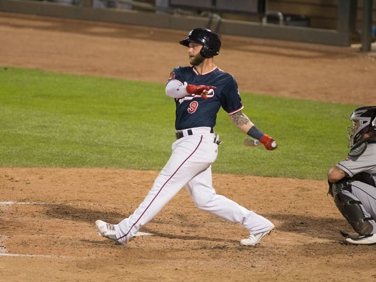 Christian Walker follows through on a swing during