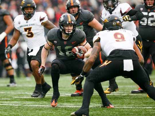 Oregon State's Timmy Hernandez (18) looks for a way past Arizona State's Jay Jay Wilson (9) on Saturday, Nov. 18, 2017, at Reser Stadium in Corvallis, Ore.  Arizona State won the game 40-24.