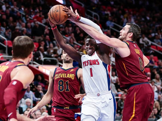 Pistons guard Reggie Jackson (1) runs against Cavaliers forward Kevin Love (0) and guard Jose Calderon (81) during the first half on Monday, Nov. 20, 2017, at the Little Caesars Arena.