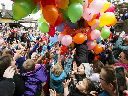 """photos by MOLLY J. SMITH/Statesman Journal Children and parents cheer as balloons drop onto the crowd at noon at the Gilbert House Children's Museum Noon Year?s Eve  party on Saturday. The museum's hands-on exhibits were open, as well as special stations for face painting, crafts and balloon animals. Children and parents cheer as balloons drop onto the crowd at noon at Gilbert House Children's Museum """"Noon"""" Year party on Saturday, Dec. 31, 2016. The museum's hands-on exhibits were open for children to play with, as well as special stations for face painting, crafts and balloon animals."""
