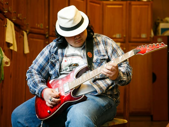 AJ Campos plays his guitar at the St. Joseph Shelter