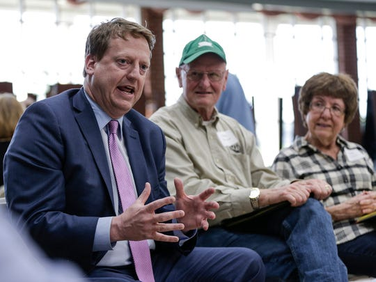 "11th Congressional District candidate Tim Greimel, left, talks to voters during a ""candidate speed dating"" event hosted by the Northville Democratic Club and Fems for Dems at Northville High School in Northville, Thursday, April 26, 2018. Next to him Dennis and his wife Carol Ringvelski, both of Novi."