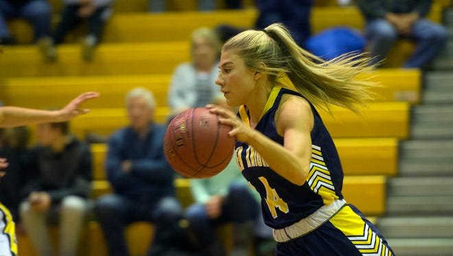 Eastern York's Hannah Myers runs the ball up the court, Tuesday, Jan. 2, 2018. The Squirettes beat the Golden Knights, 62-49.