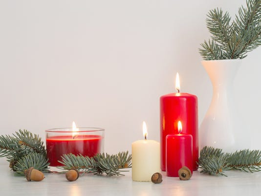Christmas decoration with candles on white background