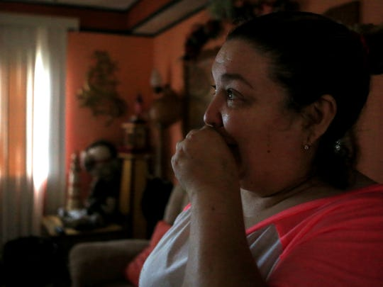 """Darlene Vasquez returned to what was going to be a retirement home to survey the damage on Monday, August 28, 2017 in Fulton, TX near Bronte Street. She said she had been unable to find information so she and her husband decided to come check out the trailer and her mother's trailer themselves. """"I was so sick and I'm still sick to my stomach,"""" she said."""