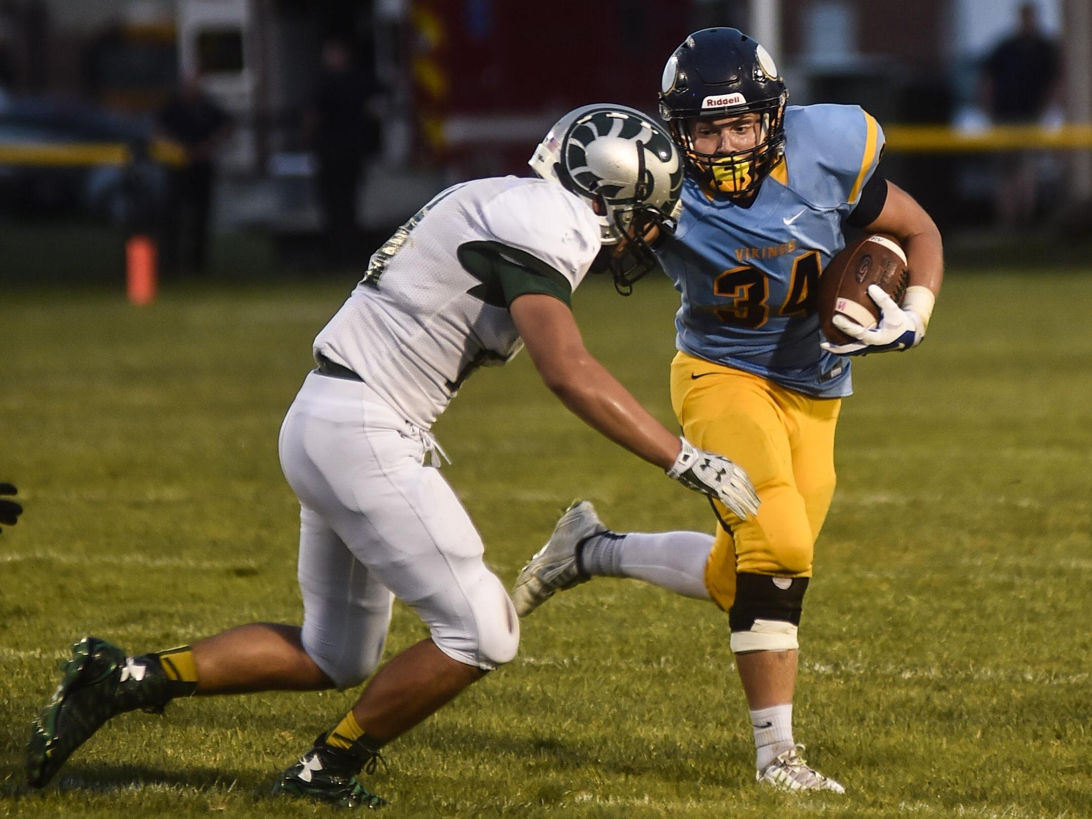 River Valley's Zach Hill looks to break through the Ram's line during the Madison vs River Valley football game on Friday.