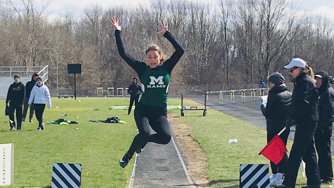 Madison freshman Kari Eckenwiler soars a personal best 17-1 to win the long jump title in the 45th Lexington Invitational.