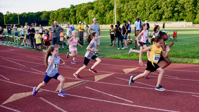Despite the heat, runners of all ages took part in the first night of the Mid-Hudson Road Runners Club's Twilight Track Series at Arlington High School in Freedom Plains Friday.