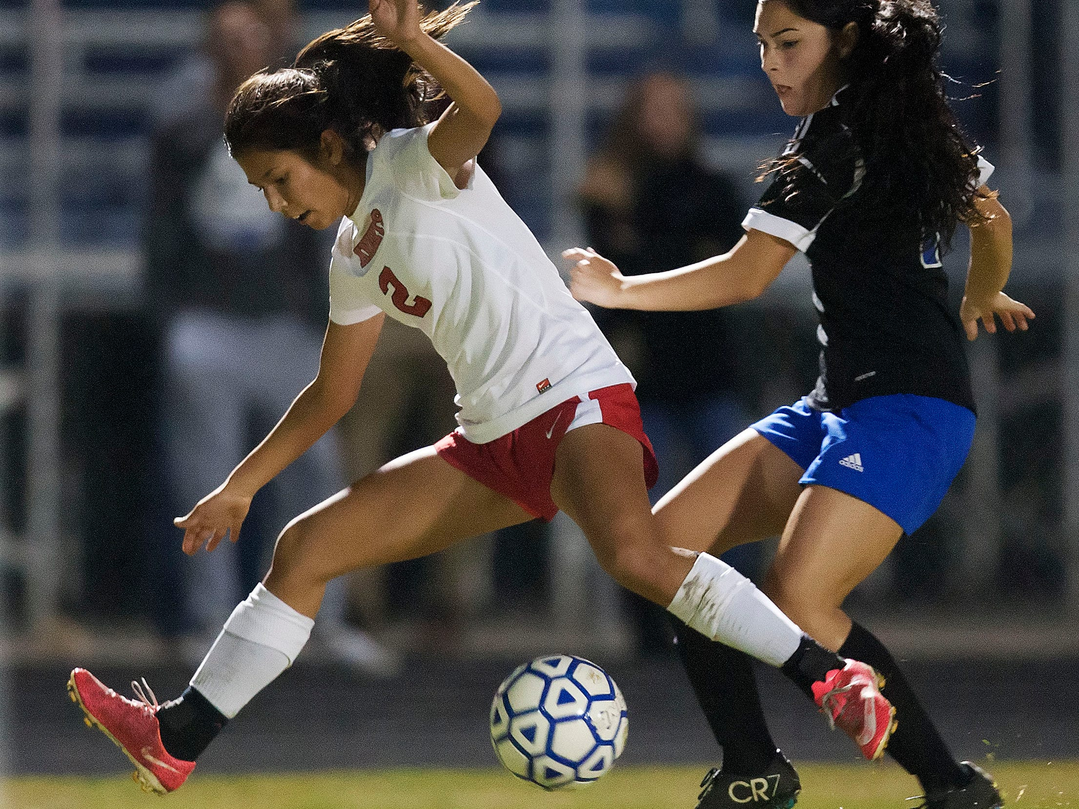 North Fort Myers High School's Makenzi Walden, left, steals the ball from Ida S. Baker's Gabby Hallnan during the District 3A-13 girls soccer final Friday at Ida S. Baker High School in Cape Coral.
