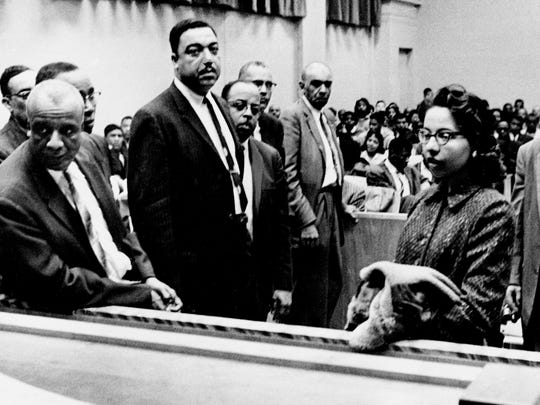 "Diane Nash, right, a Fisk University student, makes a statement that defendants in the race demonstration cases have decided not to pay fines levied against them as a matter of ""moral principle."" Nash was one of 77 defendants in the trial in Nashville City Court March 1, 1960 that were arrested for refusing to vacate downtown lunch counters."