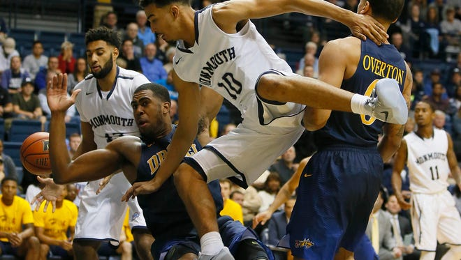 Drexel Dragons forward Austin Williams (5) defends against Monmouth Hawks guard Micah Seaborn (10) during the first half at Ocean First Bank Center,West Long Branch,NJ.Noah K. Murray-Correspondent/Asbury Park PressASB 1112 Monmouth Basketball
