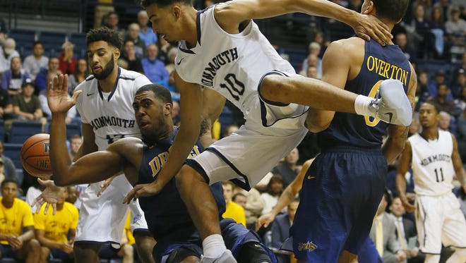 Drexel Dragons forward Austin Williams (5) defends against Monmouth Hawks guard Micah Seaborn (10) during the first half at Ocean First Bank Center,West Long Branch,NJ. Noah K. Murray-Correspondent/Asbury Park Press ASB 1112 Monmouth Basketball