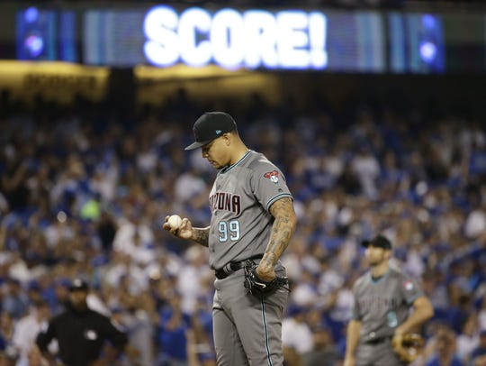 Taijuan Walker reacts after allowing a three-run home