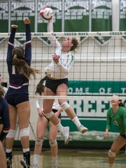 Paris Thompson of Fort Myers hits over Estero's Valerie