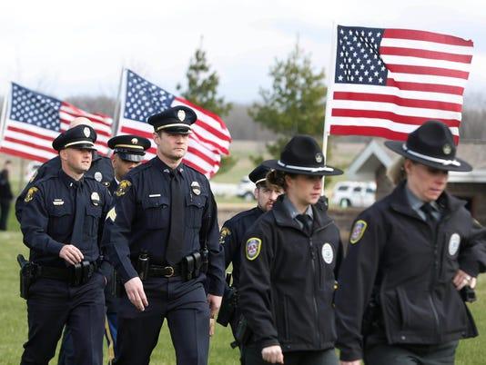 635951175967776520-0401-Officer-Funeral-10.jpg