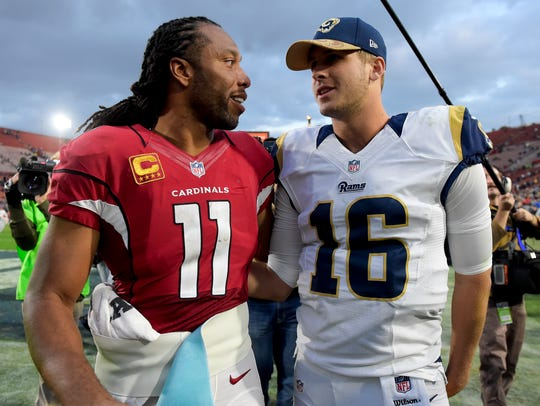 Arizona Cardinals wide receiver Larry Fitzgerald, left,