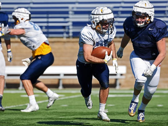 Augustana's Caden Quintanilla (25) participates in a drill during a spring football practice Friday, April 7, 2017, at Kirkeby–Over Stadium on the Augustana University campus.