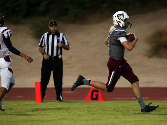 Rancho Mirage quarterback David Talley carries the ball for a touchdown against La Quinta on Friday, September 8, 2017 in Rancho Mirage.