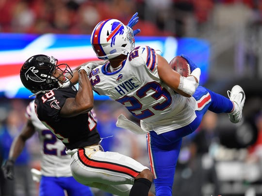 Buffalo Bills strong safety Micah Hyde (23) intercepts a pass intended for Atlanta Falcons wide receiver Taylor Gabriel (18) during the second half at Mercedes-Benz Stadium.
