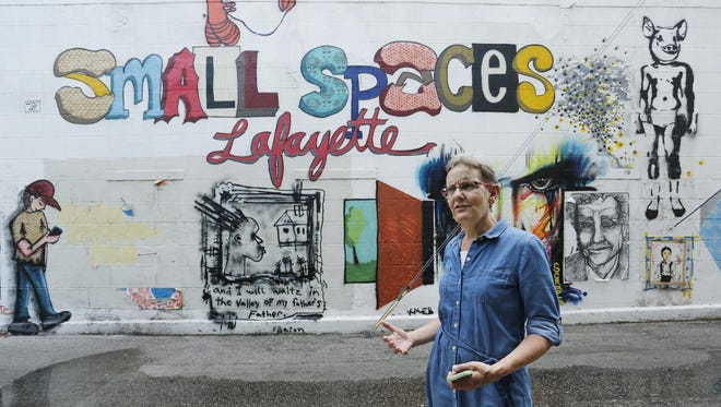 Margy Deverall describes Monday, June 15, 2015, a new mural that will be painted at the location of last summer's small spaces Lafayette mural near 2nd and Main streets in downtown Lafayette. The new mural will be based upon a Georges Seurat painting.
