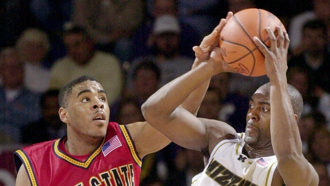 -Iowa State's Omar Bynum (1) tries to knock the ball from the hands of Missouri's Clarence Gilbert during the second half of a first-round game of the Big 12 Conference men's basketball tournament at Kemper Arena in Kansas City, Mo., Thursday, March 7, 2002. (AP Photo/Charlie Riedel)