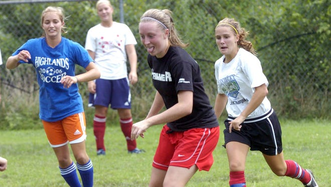 Caitlin Beck and her Highlands teammates practice on Aug. 11, 2006 in Fort Thomas.