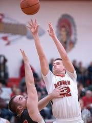 Bucyrus' Kyle Hamm shoots over Buckeye Central's Kyle