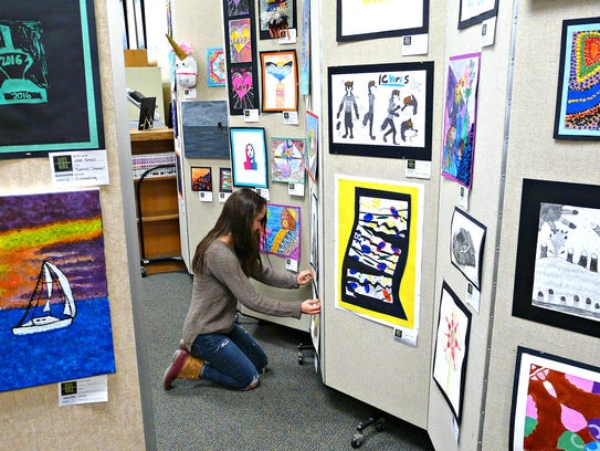 Helping to transform the school library into an art